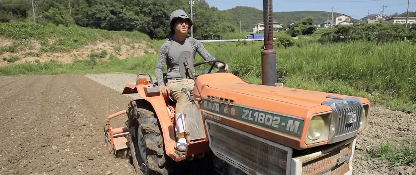 Akito plowing a new field to be planted with vegetables.